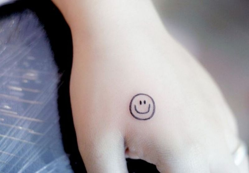 smiley face tattoo 24