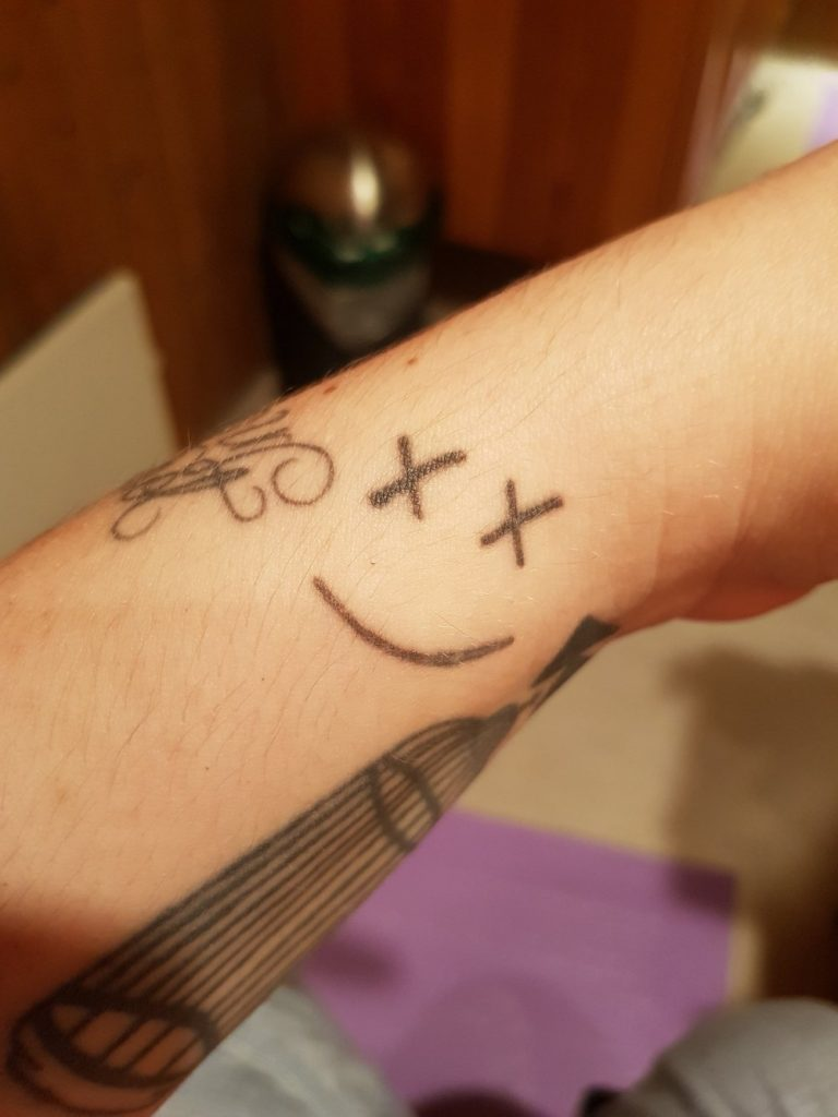 smiley face tattoo 6