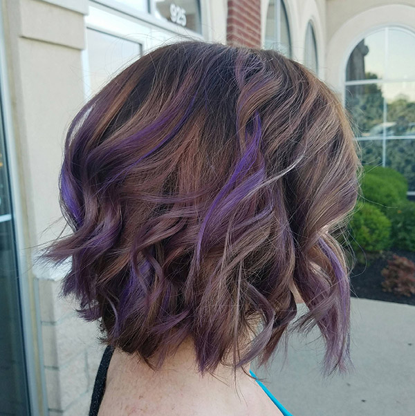 short brown hair with purple highlights