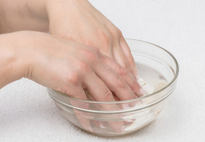 remove acrylic nails with warm water