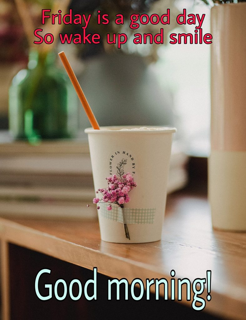 Good morning friday image with cup and flowers on the table