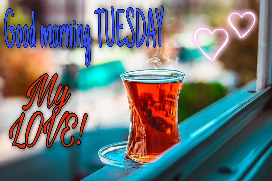 Good morning tuesday image with teacup placed on the window